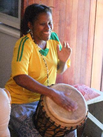 Emzini Township Tour: Ella playing and singing - Knysna Township South Africa