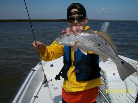 "Buras, LA: Chris and a ""rat red"" redfish, March 2010"