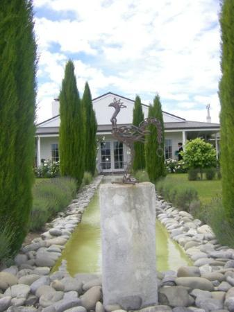 Hans Herzog Estate: Herzog Winery formal garden sculpture