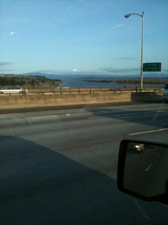 Portland, OR: Crossing the Columbia into Oregon.  Mt. Hood is covered with snow.