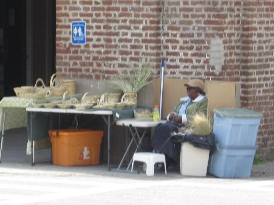Charleston, SC: She's weaving away at those baskets
