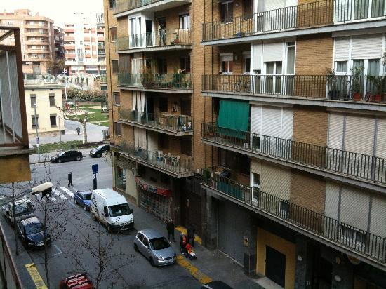 AC Hotel Lleida: View from my window, cafe on the corner.