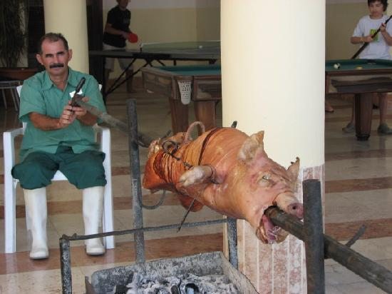 Sol Rio de Luna y Mares: hand turned pig roast by the pool