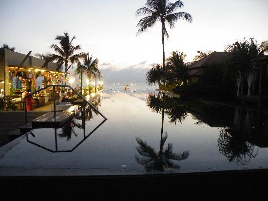Chongfah Beach Resort: the pool at sunset