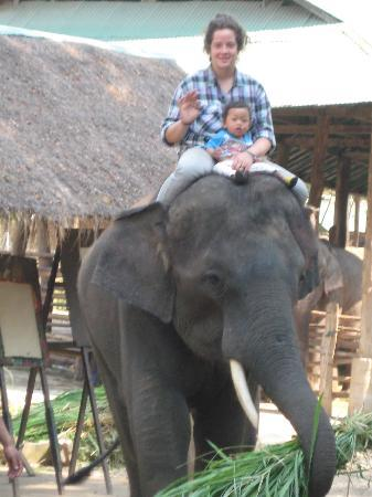 Thai Elephant Home: Daughter and owner's son go for a ride