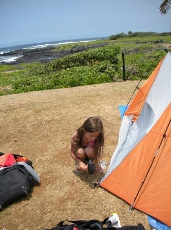 Kailua-Kona, HI: Kaitlyn helping set up the tent at Punalu'u Beach where we camped.