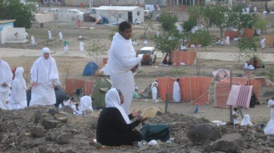 Mekka, Saudi-Arabia: Making many Dua on Mt. Arafat.  This is actually a cliff and the wind was strong, therefore I sa