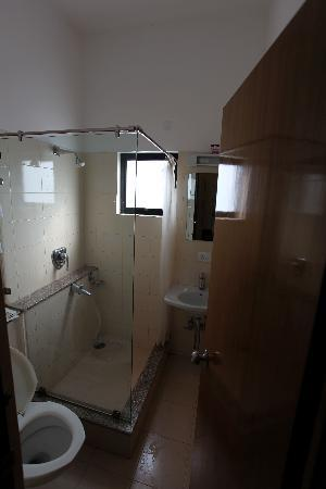 The bathroom in a guest room at Hotel Rajawas in Dibrugarh, Assam, India