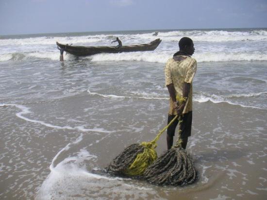 Accra, Ghana: A fisher on the beach in Ghana