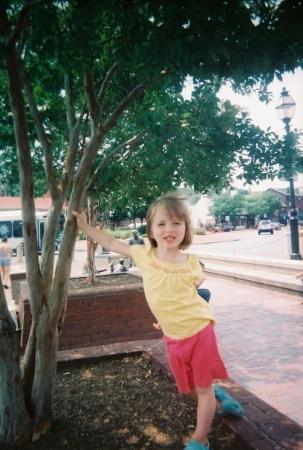 Samantha poses near the Annapolis Main Street, near the water.
