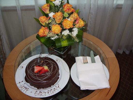 Towers Rotana: Surprise birthday cake and flowers