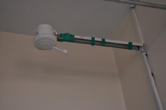 Gracehouse Resort: The shower head, secured to the water pipe with green insulation tape. Didn't appear to be a tem