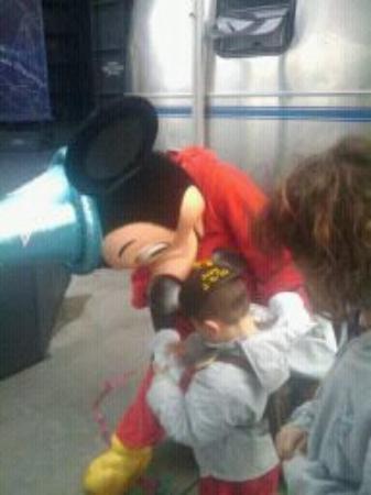 Disneyland Park: Joey trying to show Mickey his Mickey sticker.