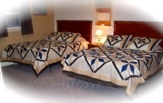 Farmington, ME: We offer three large family suites which have two queen sized beds and a full sized pull out fou
