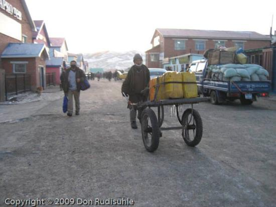 Arvayheer, Mongolia: Merchandise being transported home at the end of the shopping day in Arvaikheer.