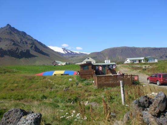 Snaefellsbaer, Iceland: A small kiosk and a trampolin, the Snæfellsnes glacier is barely showing in the backroand