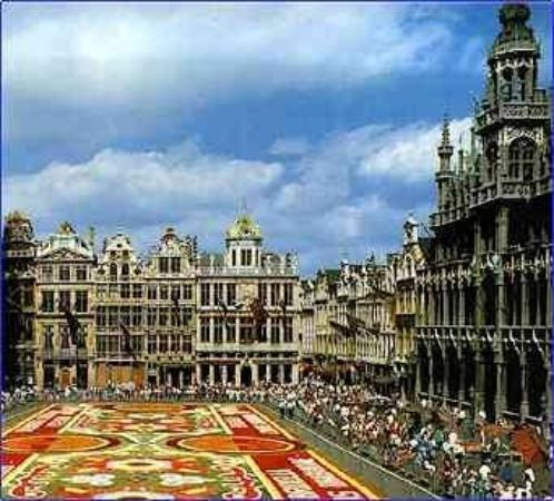 Grand-Place: The Grand Place - town hall and center.  Here are the many flowers laid down as a flower carpet.