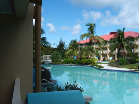 Sandals Grande St. Lucian Spa & Beach Resort: Standing on patio with steps that go right into the pool. Sandal Grande St Lucia