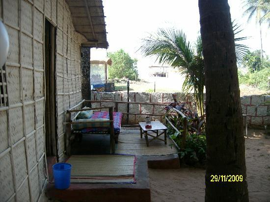 Mandrem, India: Outside view of family hut.