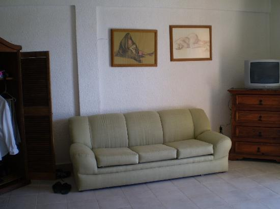 Hotel Posada Del Mar: couch, armoire, and dresser
