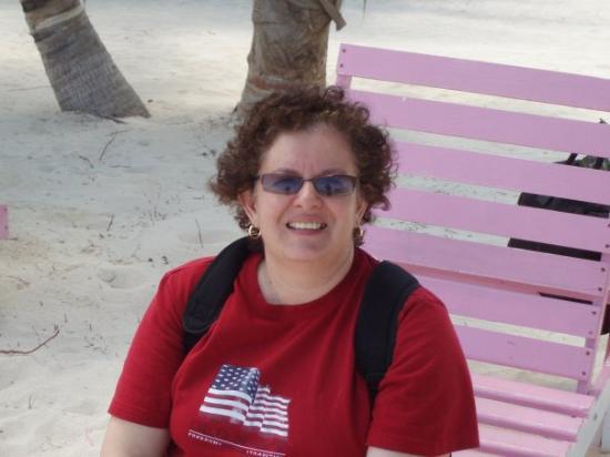 Sitting on beach at San Pedro, Belize.