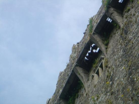 That's the Blarney Stone up there!  Blarney Castle, Ireland.