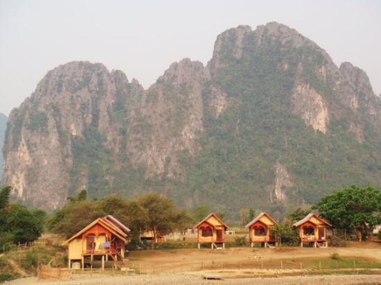 Vang Vieng, Laos: Karst Mountains - Vang Vien - I stayed in a more primitive bamboo hut than these - $5 USD a nigh
