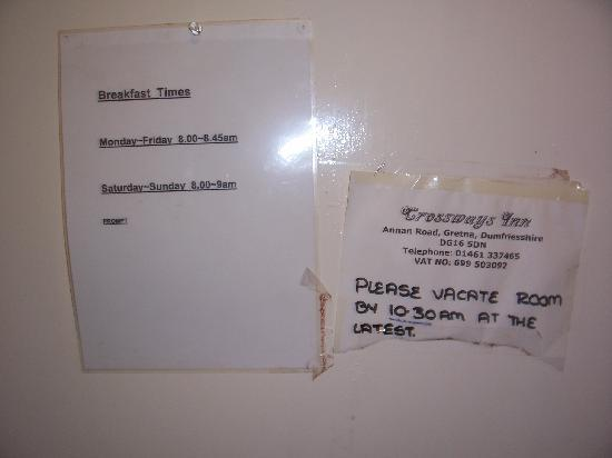The Gretna Inn: information notices taped to the back of the door