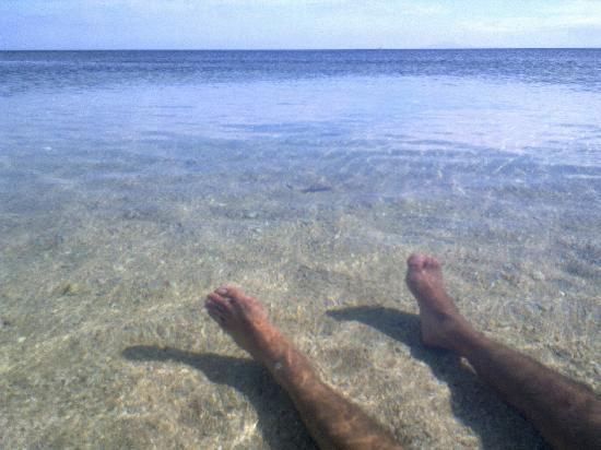 Beach Club Cagpo: EJ's feet in the incredibly clear waters