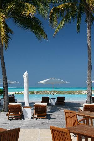 COMO Parrot Cay, Turks and Caicos: view of pool to beach and blue water
