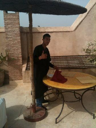 Ryad Dyor: Abdul setting out breakfast on the terrace