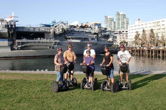 Another Side Of San Diego Tours: our group in front of the USS Midway aircraft carrier