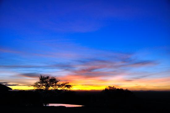 Singita Sasakwa Lodge: The sun setting over the Serengeti, viewed from the main lodge
