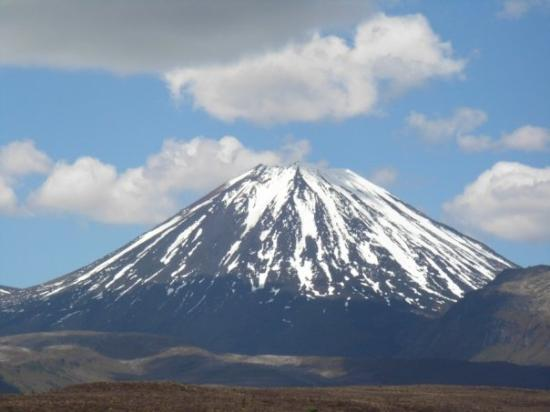 Whakapapa, New Zealand: Mt Doom (or Mt Ngauruhoe, the top of which was altered for the movie on request of the maori peo