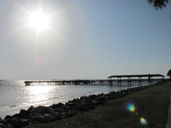 Sun setting behind the pier at Saint Simons Island, GA, United States