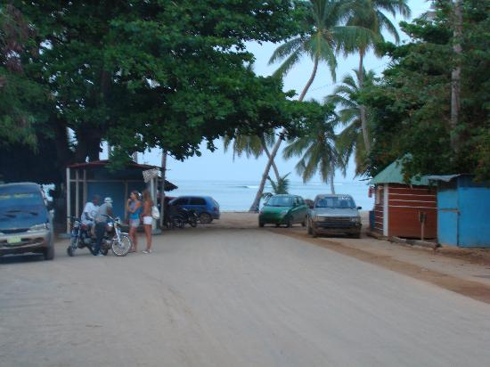 "Plaza Lusitania: The main street ends at the beach. At the left you can see a ""guagua"" (van) and ""motoconchos"" (m"