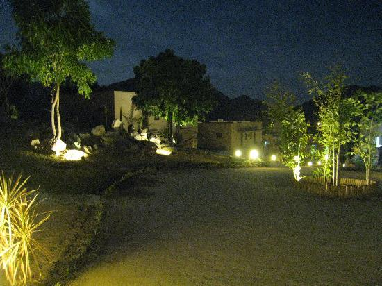 Aravali Silence Lakend Resorts & Adventures Pvt. Ltd.: Path to the Cabanas at Night