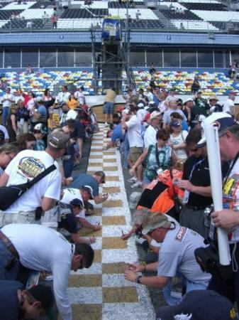 Folks Signing Their Name On The Finish Line At Daytona 500