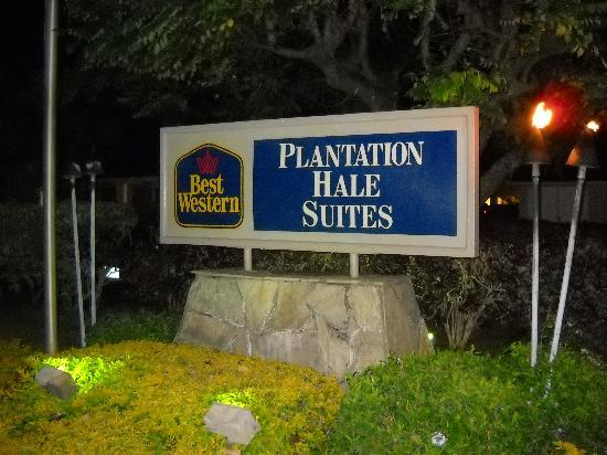 Plantation Hale Suites: the entrance sign at night tiki torches and all