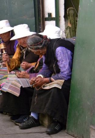 Lhasa, China: Pilgrims with Prayer Wheel