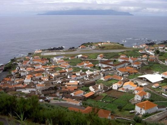 Corvo, Portugal: View of Vila Nova and its airstrip (possibly the smallest airport in the world), with the island