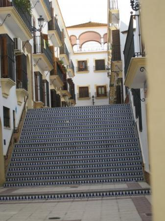 A side street in Moguer.  The stairs leading up to the building are all tiled