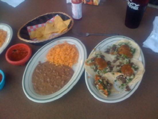 Roseburg, OR: Tacos Carne Asada with side of beans and rice