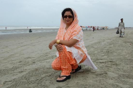 Chittagong City, Bangladesh: Posing on the beach. Not my idea, the photographer's idea. Yes, we had a professional photograph