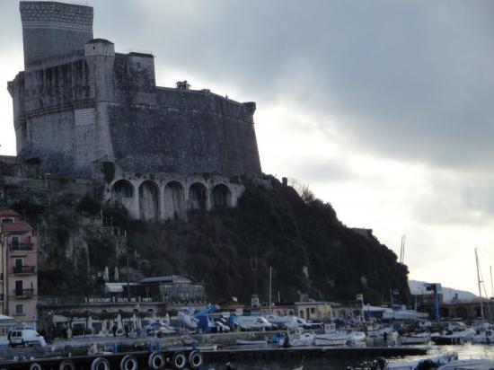 The seaside village sits, glowering under this 13th cent. Pisan fortress.  Lerici, Italy