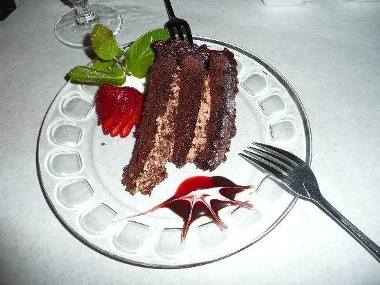 Port O' Call Restaurant and Gaslight Saloon: Chocolate cake (garnished with the sweetest strawberry)