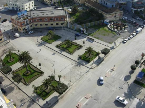 Durres, Albania: March 27th, 2010.  Looking down from the Fly Bar into a park/street/court yard in the port area