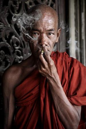 Мандалай, Мьянма: Not many monks smoke, except for some in the older ones like this monk from Mandalay.