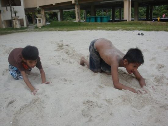 PRIMALAND Port Dickson Resort & Convention Centre (PRCC): The boys are playing with sand
