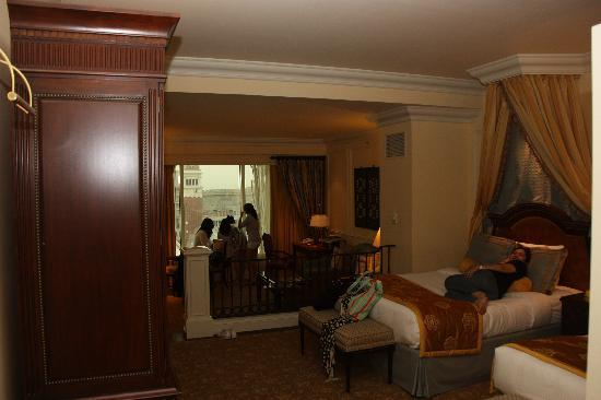 Queen Size Beds And A Living Room